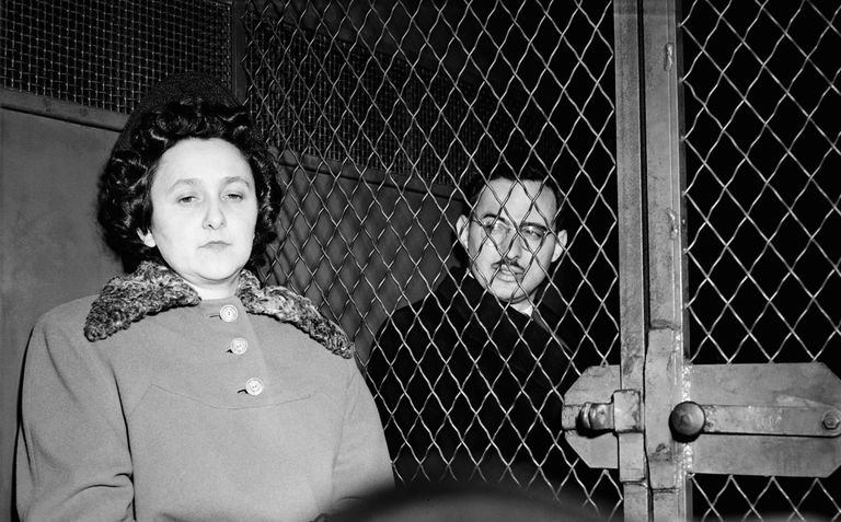 News photograph of Ethel and Julius Rosenberg in police van.