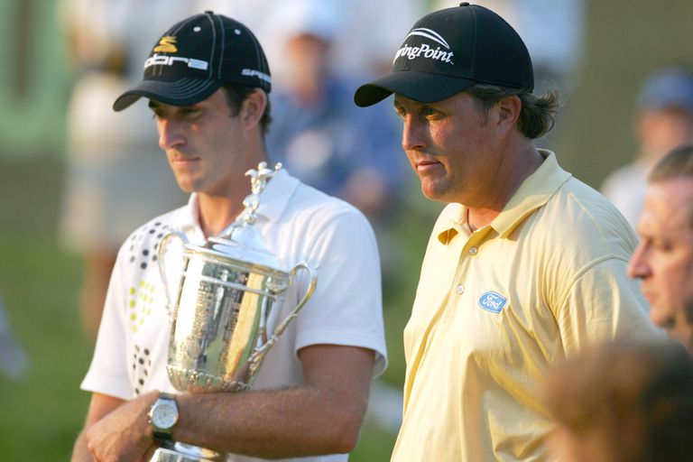 Geoff Ogilvy poses with Phil Mickelson and the trophy after winning the 2006 U.S. Open Championship at Winged Foot Golf Club in Mamaroneck, New York on June 18, 2006