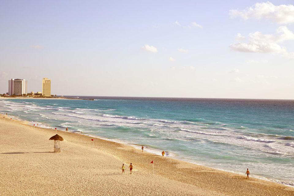 Foamy waves approach the white sand beach