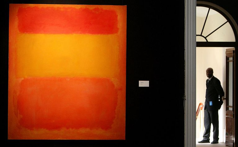 A Sotheby's security guard stands at a gallery entrace where Mark Rothko's 'Orange, Red, Yellow' is hung on April 14, 2008 in London, England. The artwork, estimated to sell for in excess GBP 30 million and is part of highlights from the New York Contemporary Art Sale to be shown in an exhibition from April 13 to 16, 2008 in Sotheby's London.