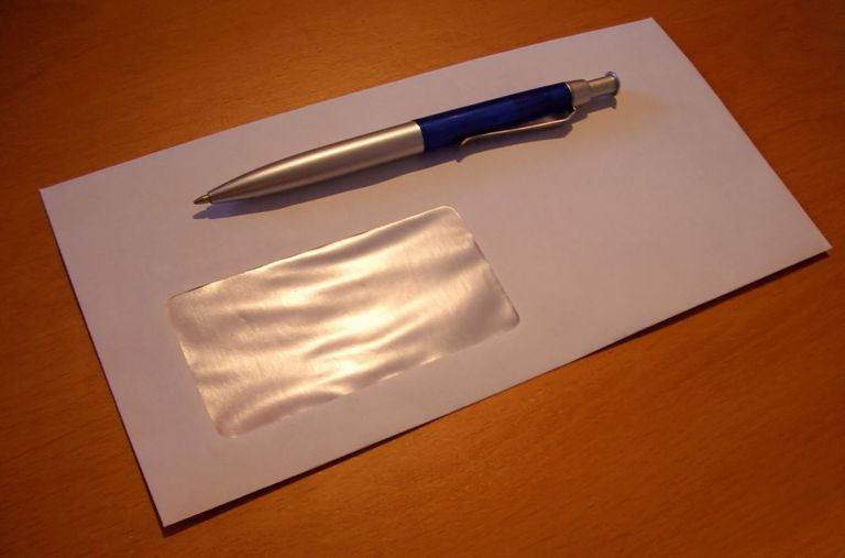 A blank envelope and a pen