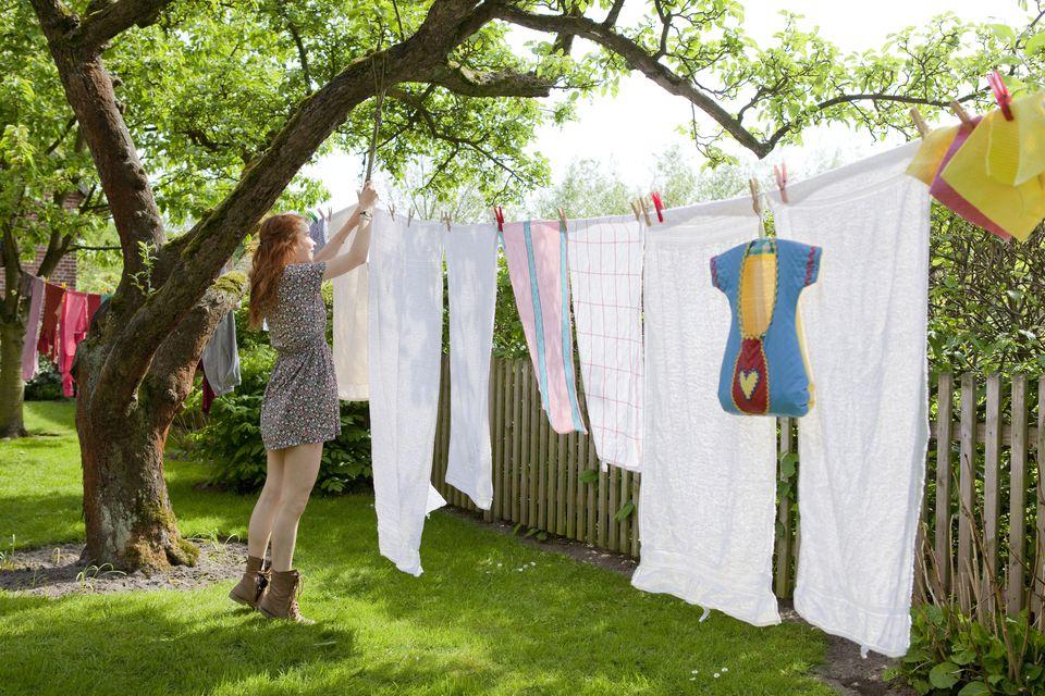 girl hanging laundry in the garden