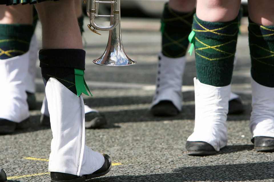 St Patrick's Day, marching band musicians on parade showing spats and green socks, close-up