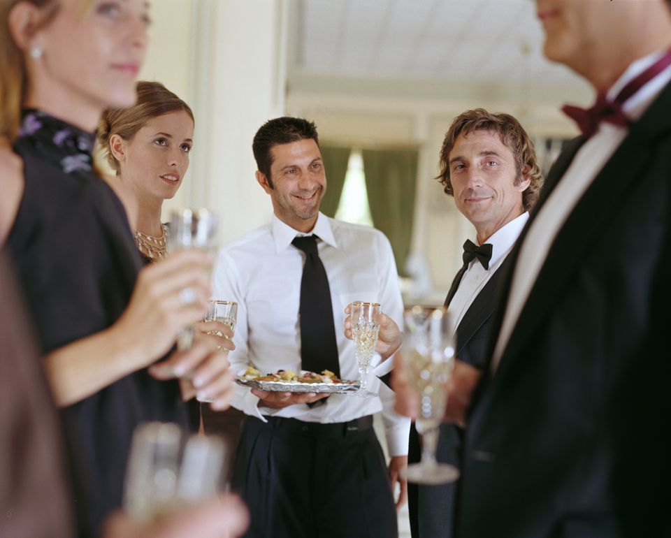 People enjoying a formal party