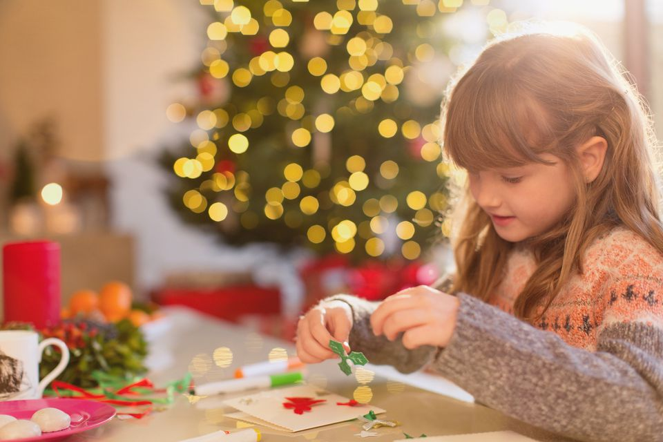 Young girl making Christmas crafts