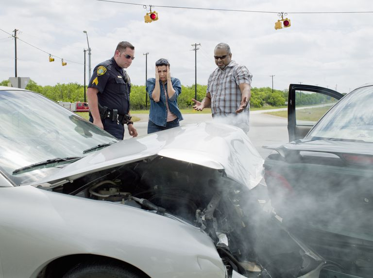 Police officer investigating at accident scene
