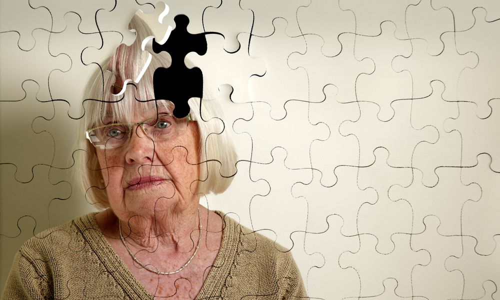 Puzzle of elderly woman with missing piece