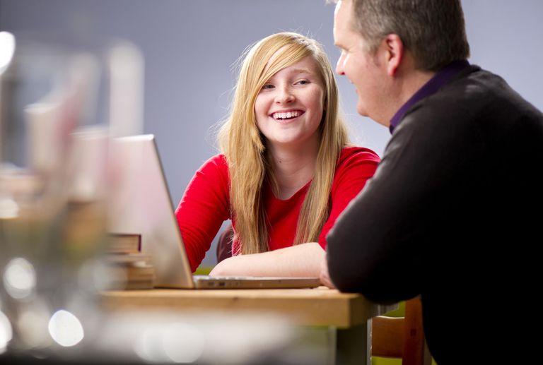 Teen showing dad her homework