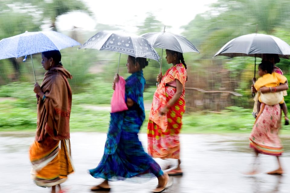 Indian women in the monsoon.