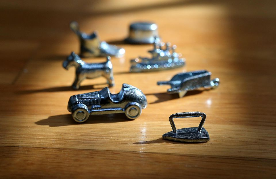 n this photo illustration, Monopoly board game pieces are displayed on February 6, 2013 in Fairfax, California.