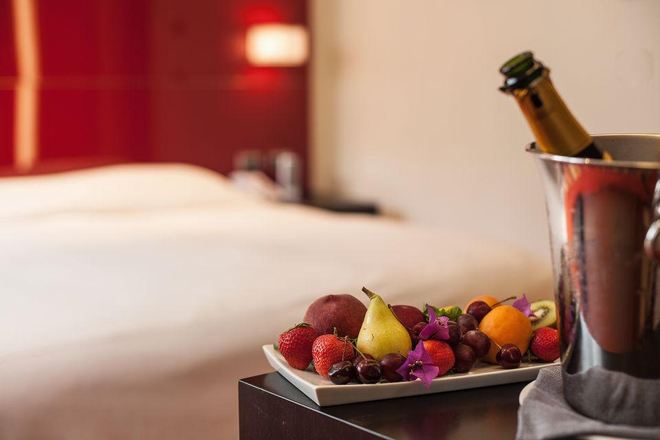 Fruit plate and champagne in hotel room.