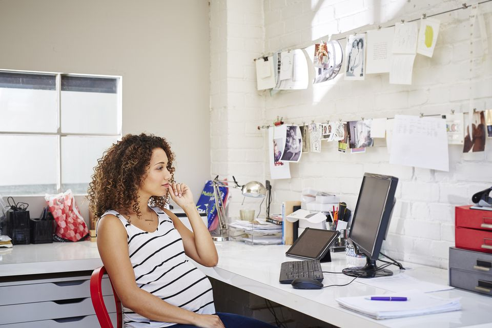 A woman sitting at her desk working from home