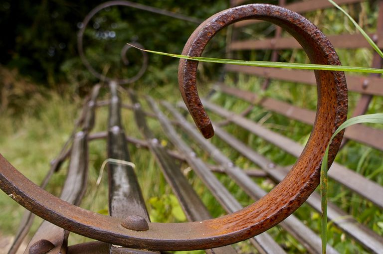 Armrest of a wrought iron bench forms a Golden spiral of the Divine Ratio, a pleasing geometry