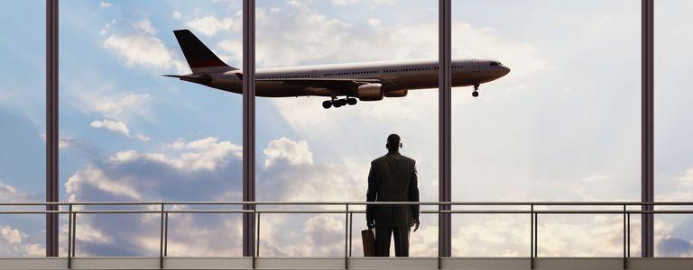 Man watching plane flight away