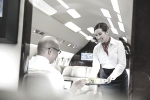 Flight attendant serving passenger