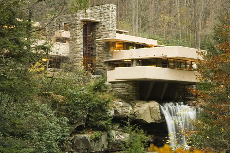 Tourists stand on cantilever decks at Fallingwater, Frank Lloyd Wright's  design in Pennsylvania