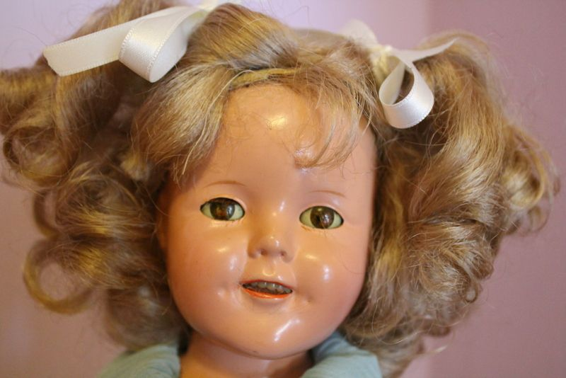 Close-up of original american Composition doll Shirley Temple