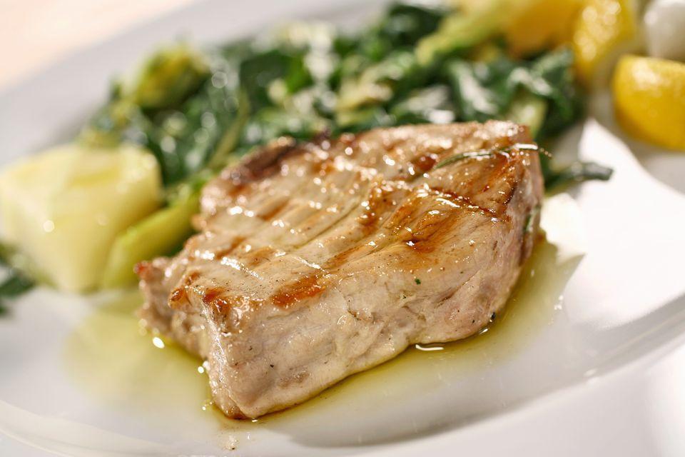 Grilled tuna steak with potatoes and chard