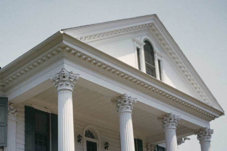 portico of antebellum plantation home, with tooth-like dentils in the pediment and the cornice