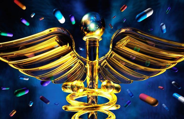 Gold colored caduceus surrounded by pills.