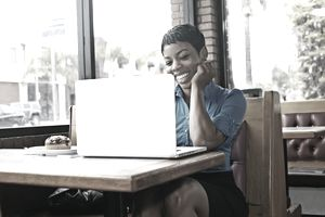 Woman on laptop at restaurant