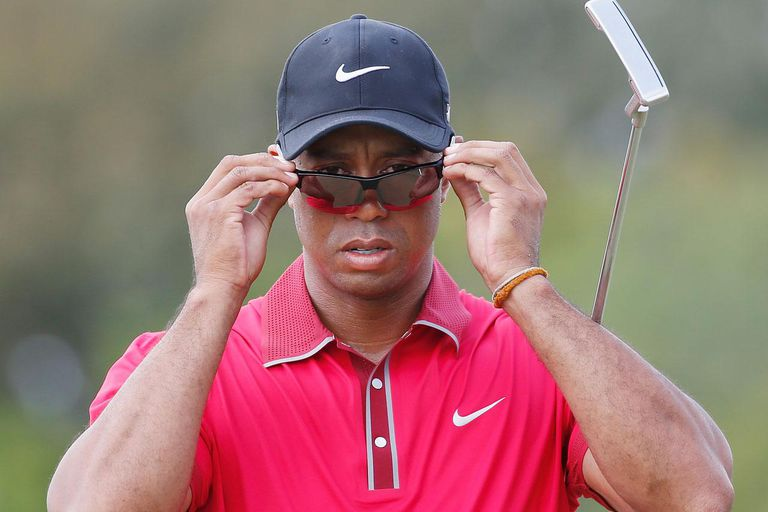 DORAL, FL - MARCH 09: Tiger Woods walks off a green during the final round of the World Golf Championships-Cadillac Championship at Trump National Doral on March 9, 2014 in Doral, Florida.