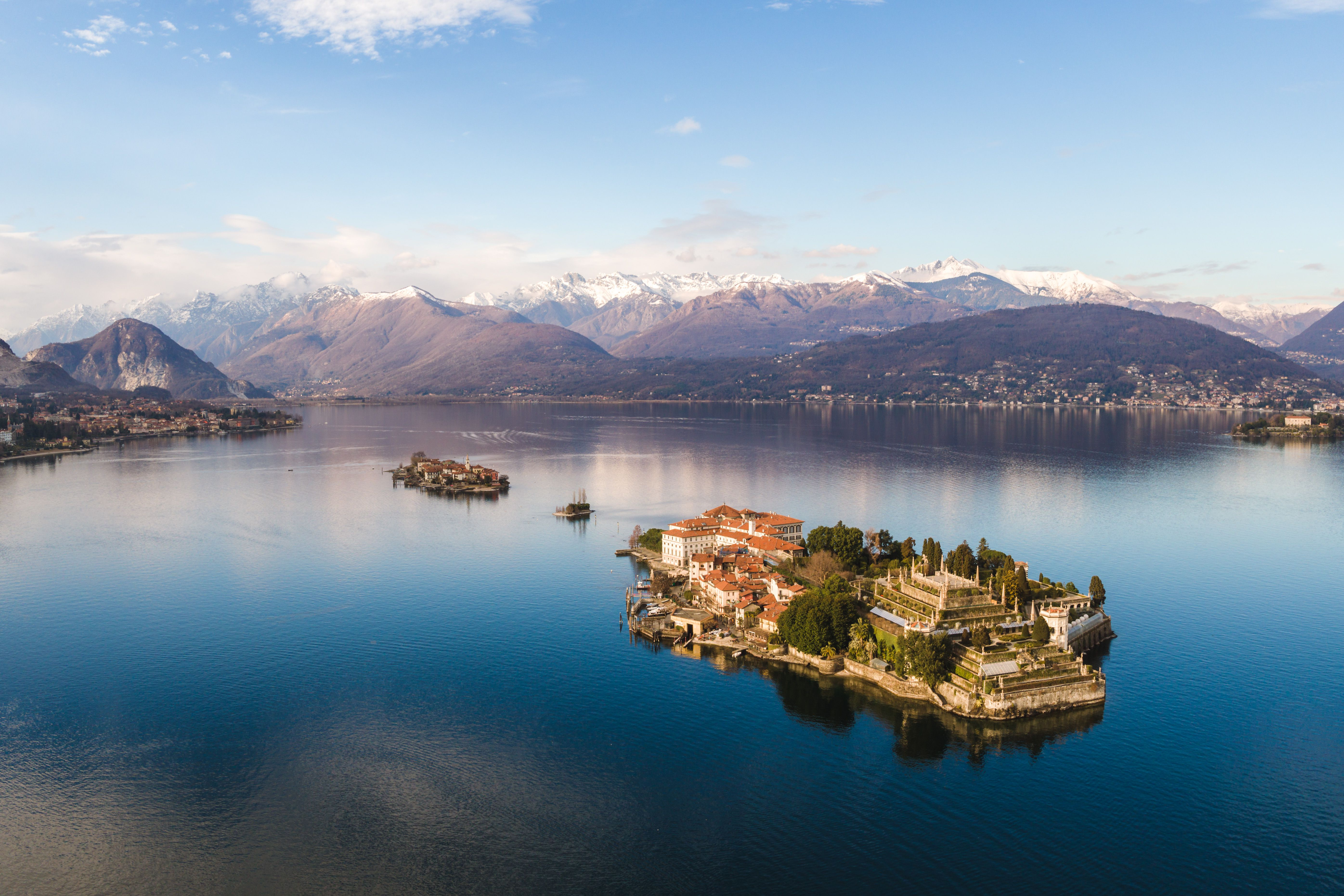Lake garda travel guide and what to see and do sunset over borromeean islands lake maggiore italy ccuart Image collections