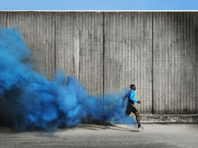 Athlete with trace of blue smoke