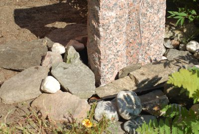 Large rocks do most of the work of concealing stone fountain's grate.