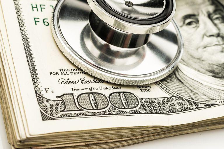 stethoscope resting on stack of &100 bills