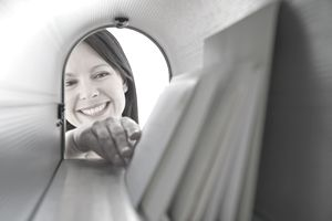 Smiling woman getting her direct mail.