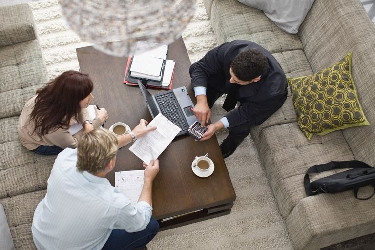 Financial adviser working with couple