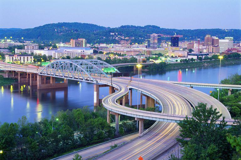 USA, West Virginia, Charleston, Kanawha River and skyline, dusk