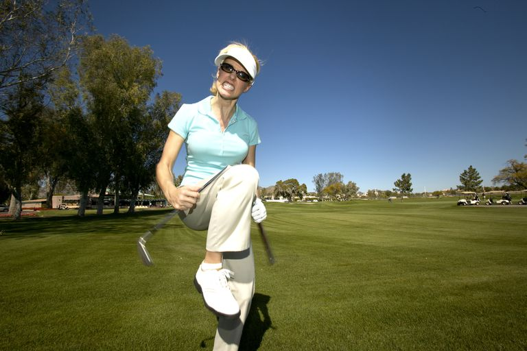 Female golfer breaks club over her knee
