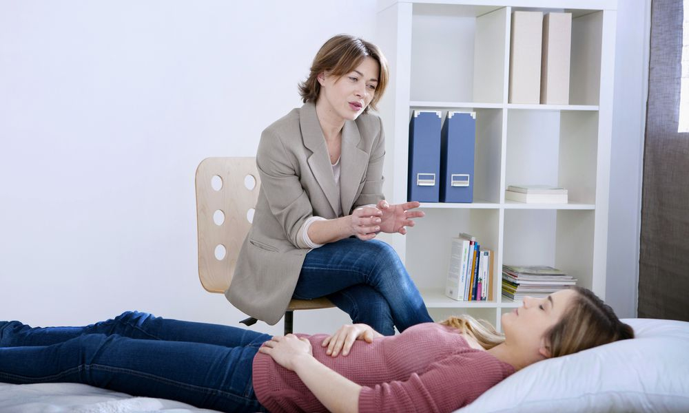 Models pose as hypnotherapist and client