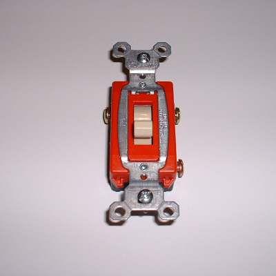 A photo of a three-way switch.