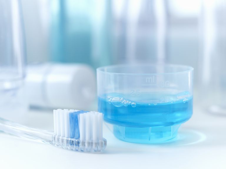 Close up of toothbrush and mouthwash