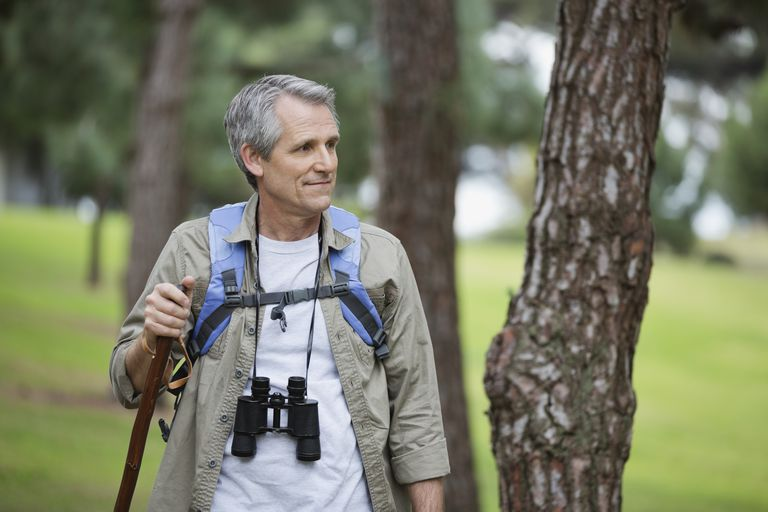 Mature male hiker looking away in forest