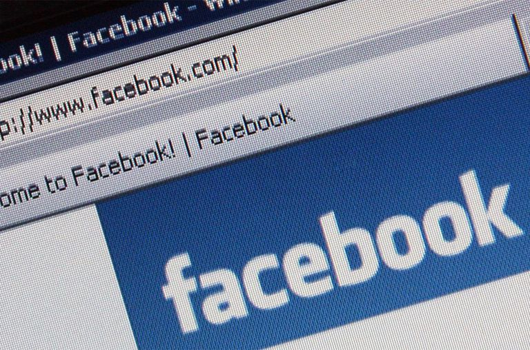 The Social networking site Facebook is displayed on a laptop screen