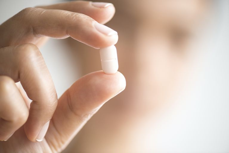 A woman holding a placebo