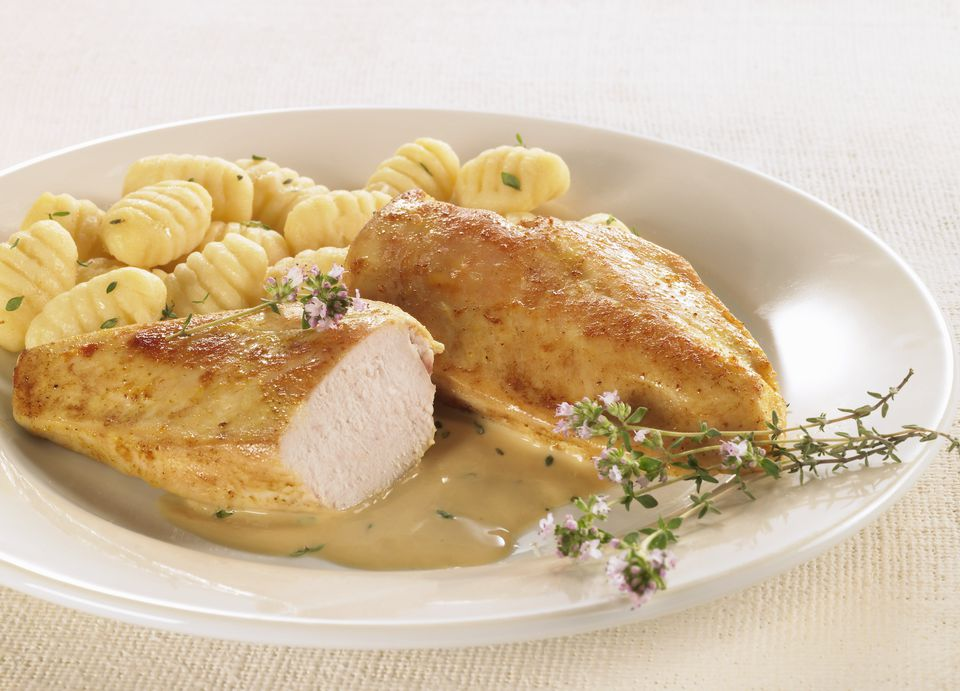 Fried chicken breast with thyme sauce and gnocchi