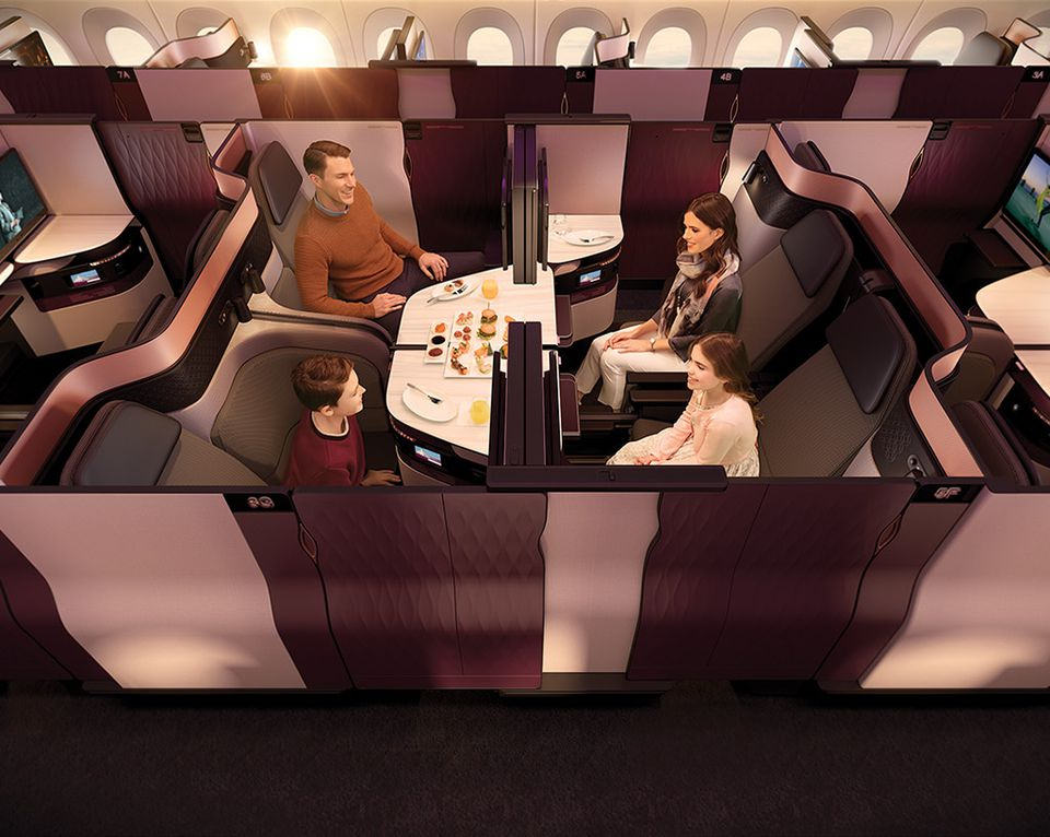A group of Qatar Airways QSuite business seats/