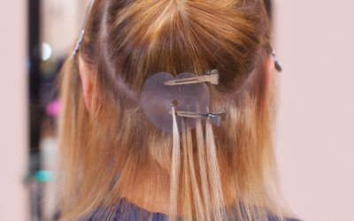 How to place clip in hair extensions diy hair extensions the hairdresser does hair extensions to a young girl a blonde in a beauty salon solutioingenieria Images