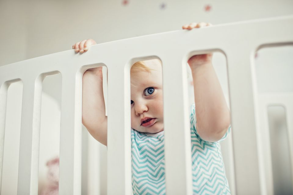 Baby in a cot