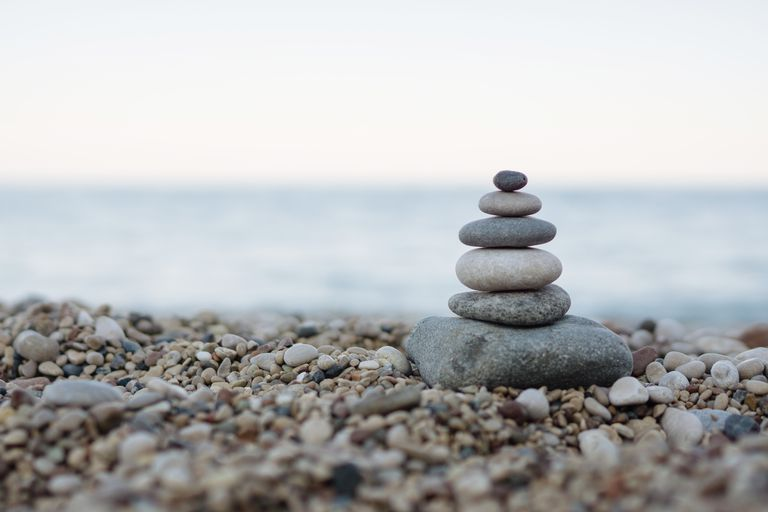 Balanced stones on a pebble beach