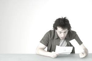 Man reading letter with surprising news