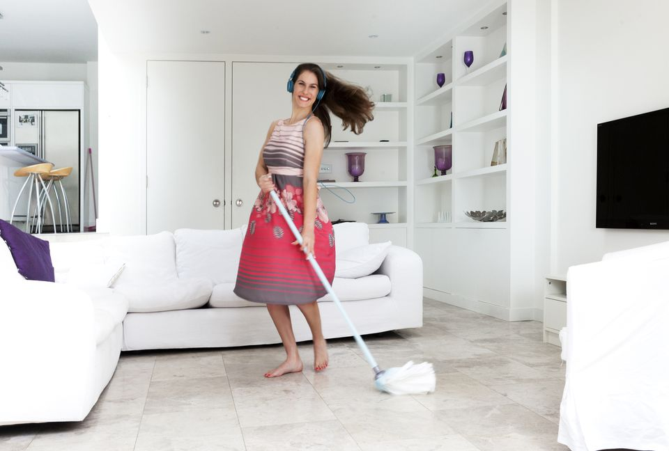 A Young Woman Mopping