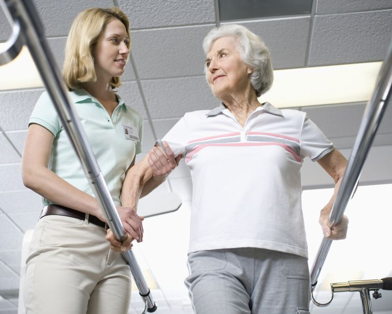 Photo of physical therapist working with older adult.