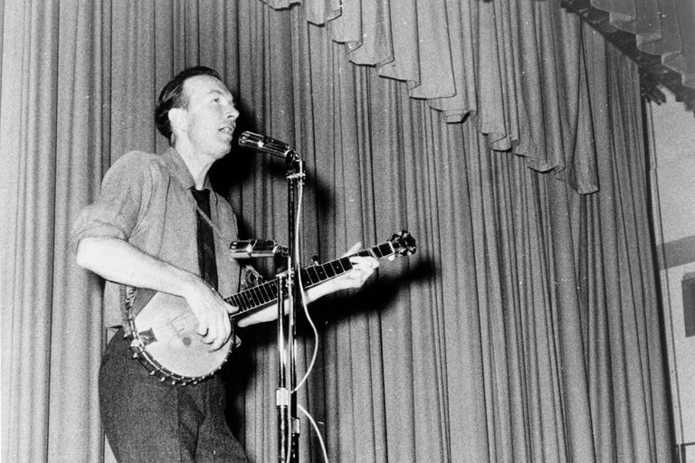 Pete Seeger, full-length portrait, performing on stage at Yorktown Heights High School, Yorktown, N.Y. / World Journal Tribune photo by James Kavallines, 1967.