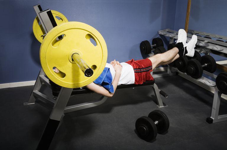 Man sleeping on weight bench